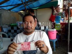 Boy(36), pedagang yang menemukan uang palsu Di Pameran